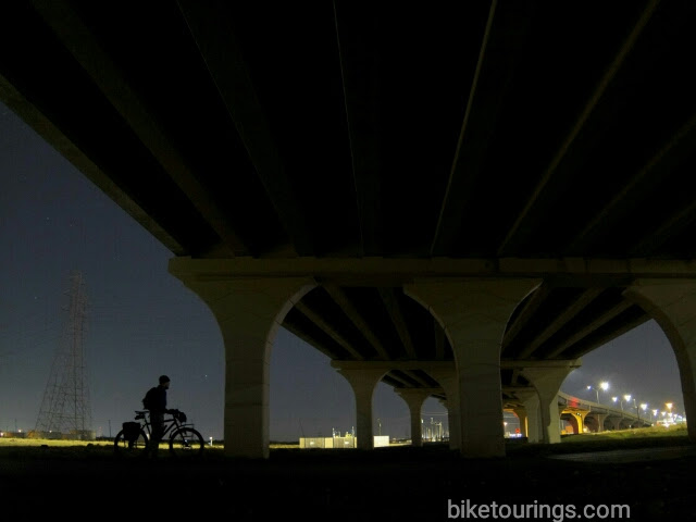 Picture of bike commuter and bridge at night