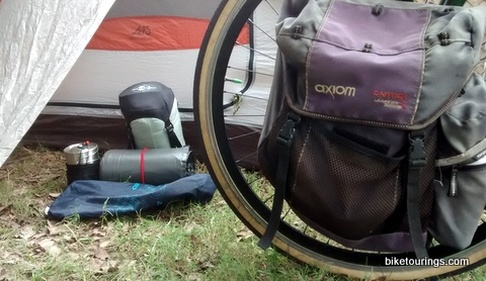 Picture of touring bike with assorted gear for packing kit.
