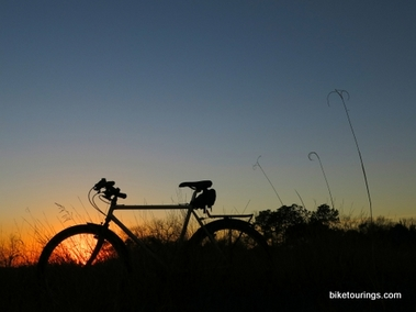 Picture of bike for touring and commuting silhouette sunset