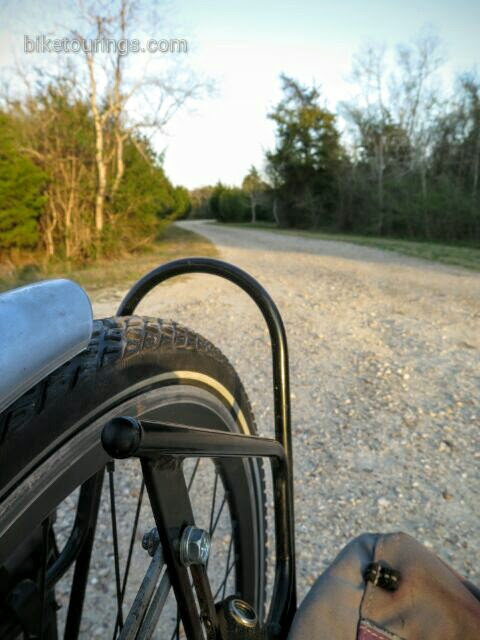 Picture of Schwalbe Mondial tires on touring bike riding gravel road