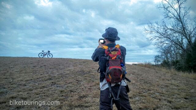 Picture of touring bike and photographer while bicycle touring.